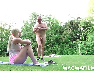 Russian babe gets a massage from grandpa in the park
