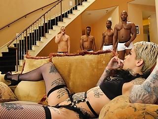 Cum loving slut Leigh Raven in stockings fucked in interracial orgy