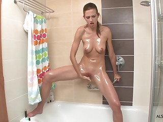 Skinny wench Eufrat masturbates in transmitted to shower